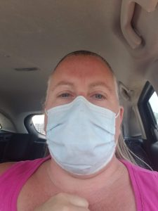 Woman in pink shirt wearing a facemask